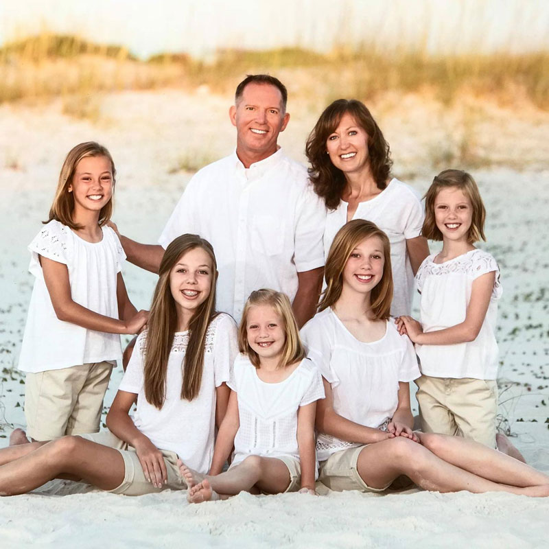Grants Pass, OR dentist Jon Robinson DMD, MS with smiling family