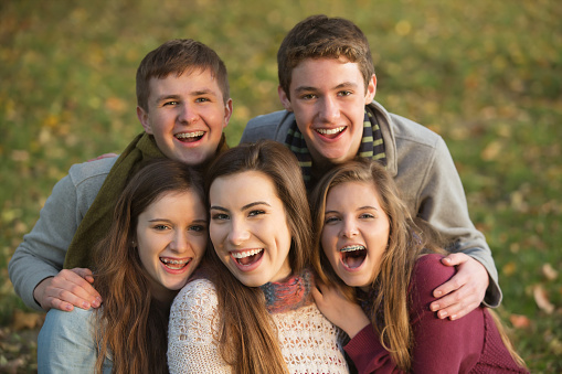 teens with braces smiling at Robinson Orthodontics