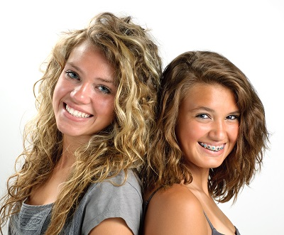 smiling teen girls with braces from Grants Pass at Robinson Orthodontics