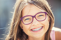 girl with braces who was treated at Robinson Orthodontics
